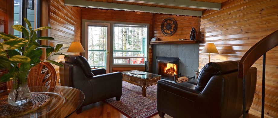 view from cozy living room to private hot tub deck at Jacob's Creek Cabin 12 at point no point resort on vancouver island